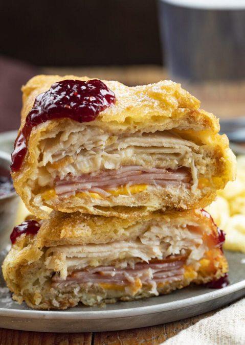 Monte Cristo Sandwich with ham, turkey, cheese and honey