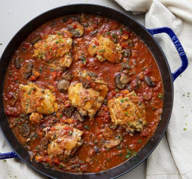 Chicken Cacciatore in a tomato-based sauce full of herbs and vegetables